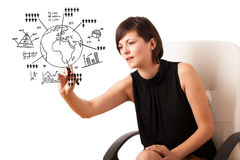 Woman drawing globe with diagrams Stock Images