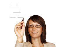 Woman drawing a graph Royalty Free Stock Photography