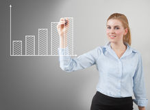 Woman drawing graph Stock Photo