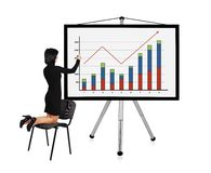 Woman drawing graph. Woman standing on a chair and drawing graph Royalty Free Stock Photo
