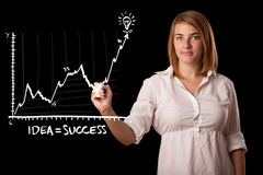 Woman drawing graph on whiteboard Stock Photo