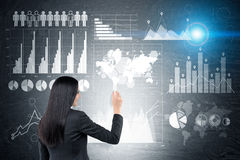 Woman drawing graphs on blackboard. Stock Images