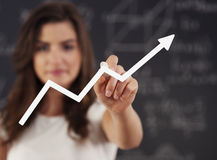 Woman drawing a growth Royalty Free Stock Image
