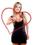 Woman drawing a heart Stock Photo