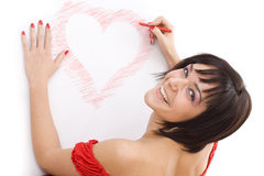 Woman drawing heart-shape Royalty Free Stock Photo