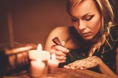 Woman drawing  henna menhdi ornament Stock Images