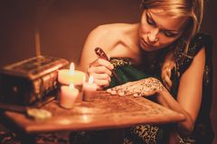 Woman drawing  henna menhdi ornament Royalty Free Stock Photos