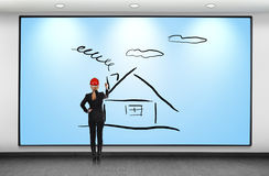 Woman drawing house Stock Images