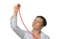 The woman drawing increasing a line of the diagram Royalty Free Stock Photography