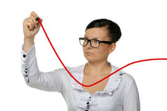 The woman drawing increasing a line of the diagram Royalty Free Stock Images