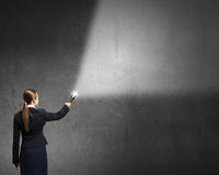 Woman drawing with lantern light Stock Photography