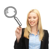 Woman drawing magnifier Royalty Free Stock Photos