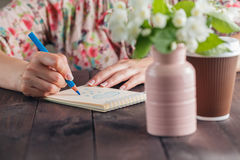 Woman drawing on notebook paper Royalty Free Stock Photos