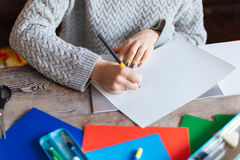 Woman drawing on paper Stock Photos
