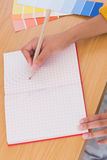Woman drawing on a paper Royalty Free Stock Photography