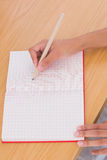 Woman drawing on a paper with a pencil Royalty Free Stock Image