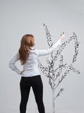 Woman drawing plant Royalty Free Stock Images