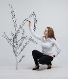 Woman drawing plant Royalty Free Stock Photography