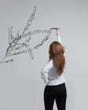 Woman drawing plant Stock Image