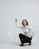 Woman drawing plant Stock Photography