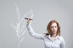Woman drawing plant Stock Photos