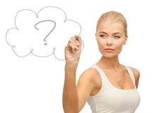 Woman drawing question mark Stock Photography