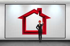 Woman drawing red house Stock Photo
