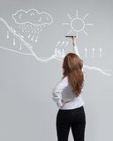 Woman drawing schematic representation of the Stock Photography
