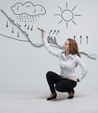 Woman drawing schematic representation of the Stock Image