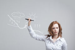 Woman drawing schematic representation of the Royalty Free Stock Photo