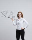 Woman drawing schematic representation of the Stock Photos