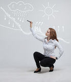 Woman drawing schematic representation of the Royalty Free Stock Photography