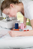 Woman drawing a sewing pattern Royalty Free Stock Photo