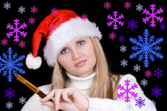 Woman drawing  snowflakes Stock Photo