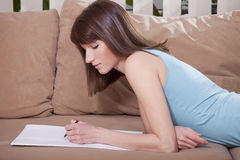 Woman drawing on sofa Royalty Free Stock Photos