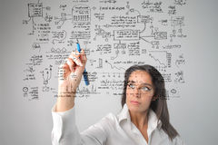 Woman drawing a system Royalty Free Stock Photo