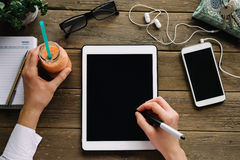 Woman drawing on tablet on desk at home Royalty Free Stock Photo