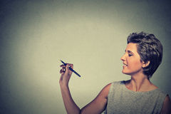 Woman drawing writing on board with empty copy space Royalty Free Stock Images