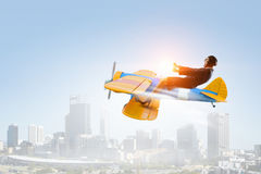 Woman in drawn airplane . Mixed media . Mixed media Royalty Free Stock Image