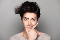 Woman with Drawn Mustaches Stock Image