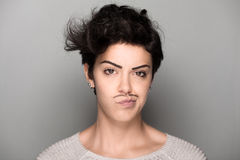 Woman with Drawn Mustaches Royalty Free Stock Images