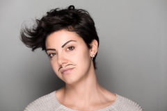 Woman with Drawn Mustaches Royalty Free Stock Photography