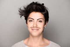 Woman with Drawn Mustaches Royalty Free Stock Photo