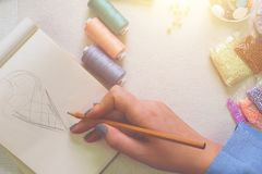 Concept. Woman draws concept at her workshop. Flat lay royalty free stock photography