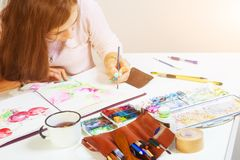 Woman draws flower royalty free stock photos