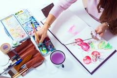 Woman draws flower stock image