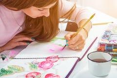 Woman draws flower stock photo