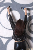 Woman draws graffiti Royalty Free Stock Photography