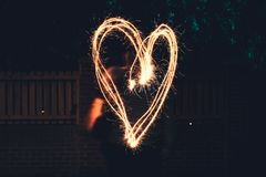 A large heart drawn out with a sparkler royalty free stock images
