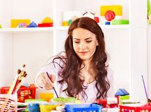 Woman draws paints. Royalty Free Stock Image